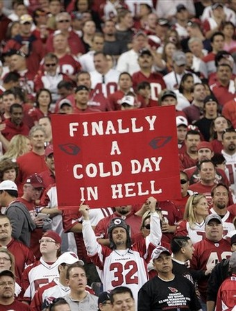 "An Arizona Cardinals fan holds up a sign that reads "" Finally a cold day in hell"" during the first quarter  of an NFC wild card playoff football game between the Cardinals and Atlanta Falcons at the University of Phoenix Stadium in Glendale, Ariz, on Saturday, Jan. 3, 2009. Its the Cardinals first home playoff game since the then-Chicago Cardinals beat the Philadelphia Eagles to win the NFC championship in 1947. (AP Photo/Matt York)"