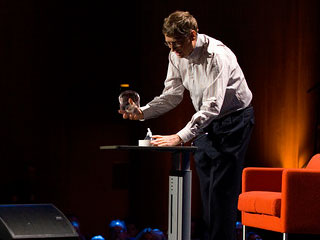 Bill Gates opens a jar of mosquitoes at TED2009.