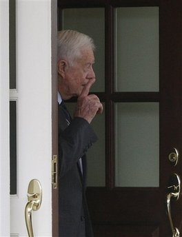 Former President Jimmy Carter looks out the door of the West Wing as he leaves the White House in Washington, Wednesday, March 18, 2009, after meeting with President Barack Obama's National Security Adviser James Jones.  (AP Photo/Ron Edmonds)