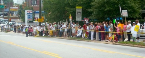 Protestors line route along drive to TOTUS Town Hall in Raleigh, NC today. Photo: Randy's Right. click image for full report on turnout.