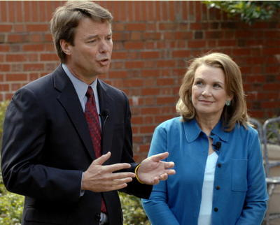 CHAPEL HILL, NC - MARCH 22:  Elizabeth Edwards listens to her husband, Democratic presidential hopeful John Edwards speak at a news conference concerning the return of her cancer March 22, 2007 in Chapel Hill, North Carolina. Elizabeth said that the former U.S. senator would continue his run for the presidency.  (Photo by Sara D. Davis/Getty Images) Cuz nothing could be allowed to stand in the way of Breck Boy's wgo right Liz? Not your cancer, not his affair, not the fact that he would drag the whole party down, nothing. Frakkers.