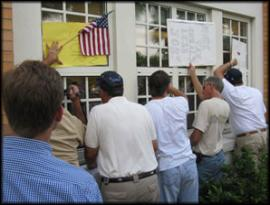 They have signs and a flag, they arent breaking glass, they want to be heard it appears...