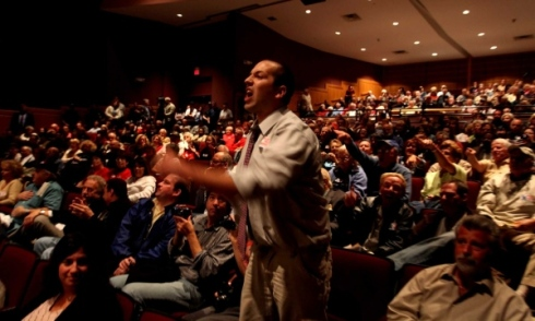 Photo credit: Pablo Corradi | Anthony Tolda, a financial consultant who lives in Huntington, becomes upset at Steve Israel's answer to his question during the town hall meeting on health care reform at Suffolk County Community College on Monday. (Oct. 5, 2009)
